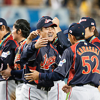 23 March 2009: Manager Tatsunori Hara of Japan celebrates with #52 Munenori Kawasaki after defeating Korea during the 2009 World Baseball Classic final game at Dodger Stadium in Los Angeles, California, USA. Japan defeated Korea 5-3