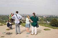 People admire the view from the Krakus Mound in Podgorze Krakow Poland