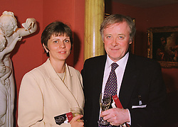 MR & MRS GERRY ROBINSON he is chairman of Granada PLC at a reception in London on 10th June 1998.MIE 103