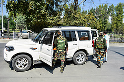 October 3, 2018 - Srinagar, J&K, India - Indian government forces can be seen inspecting a vehicle during a search operation in Srinagar..Security forces have intensified searches and frisking in the summer capital, Srinagar to foil any attempt by militants to smuggle arms and ammunition into the city, which has witnessed an increase in militant activities. (Credit Image: © Saqib Majeed/SOPA Images via ZUMA Wire)