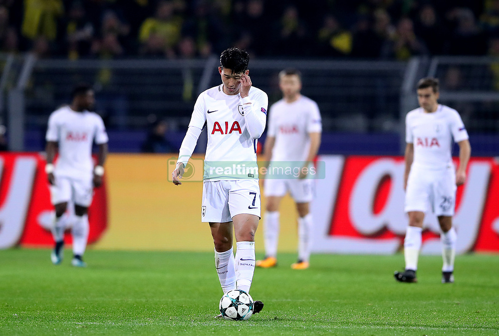 Tottenham Hotspur's Son Heung-Min appears dejected after Borussia Dortmund's Pierre-Emerick Aubameyang (not in picture) scores his side's first goal of the game