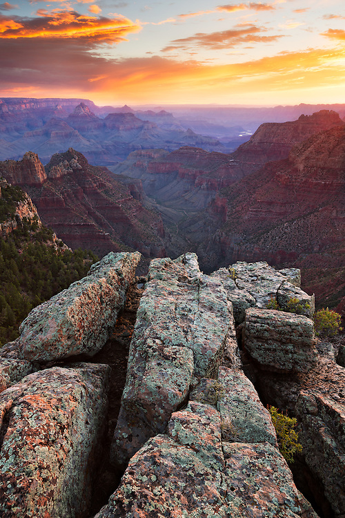 Sunrise from the South Rim of Grand Canyon National Park. In the distance, visible as a small ribbon of silver, is the Colorado River.
