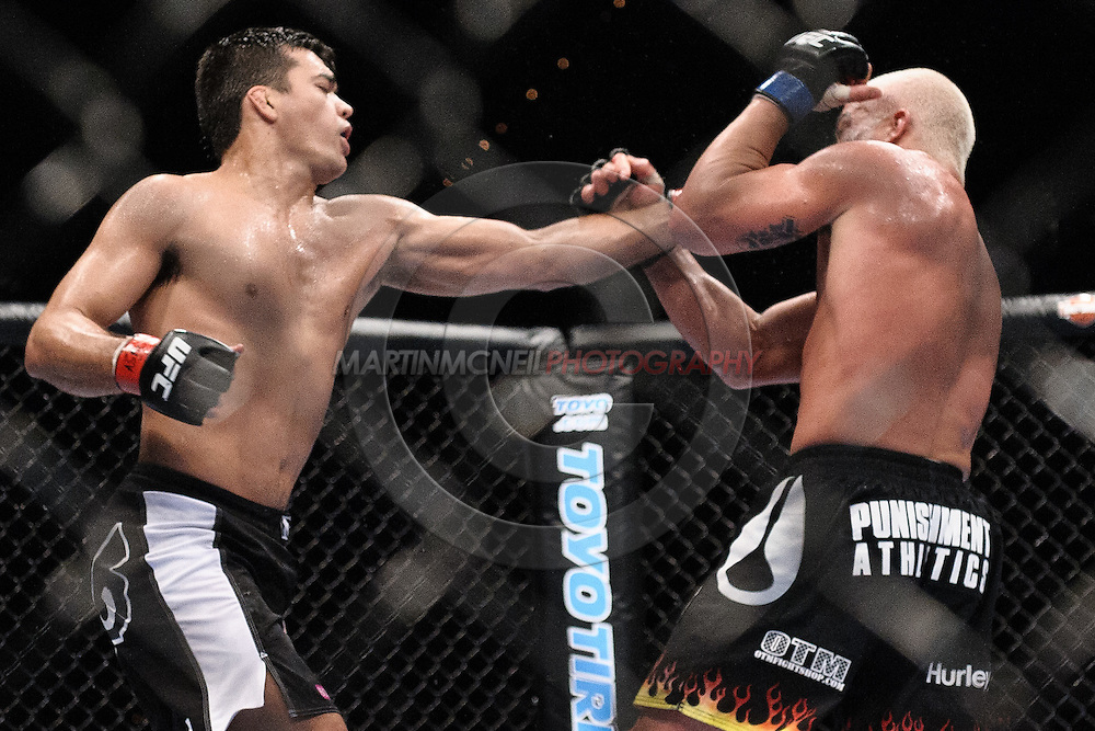 "LAS VEGAS, NEVADA, MAY 24, 2008: Lyoto Machida (left) lands a left jab through the guard of Tito Ortiz during ""UFC 84: Ill Will"" inside the MGM Grand Garden Arena in Las Vegas"