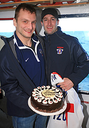 Miha Rebolj and Tomaz Razingar with a cake at whale watching boat when Poloncic (18), Golicic (17), Rebolj (27) and Razingar (9) were celebrating an anniversary of playing for Slovenian National Team for 100 (120) times, during IIHF WC 2008 in Halifax,  on May 07, 2008, sea at Halifax, Nova Scotia,Canada.(Photo by Vid Ponikvar / Sportal Images)