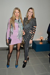 Left to right, MARIA-THERESIA PONGRACZ and CARINA HANDL at the Future Contemporaries Party in association with Coach at The Serpentine Sackler Gallery, West Carriage Drive, Kensington Gardens, London on 21st February 2015.