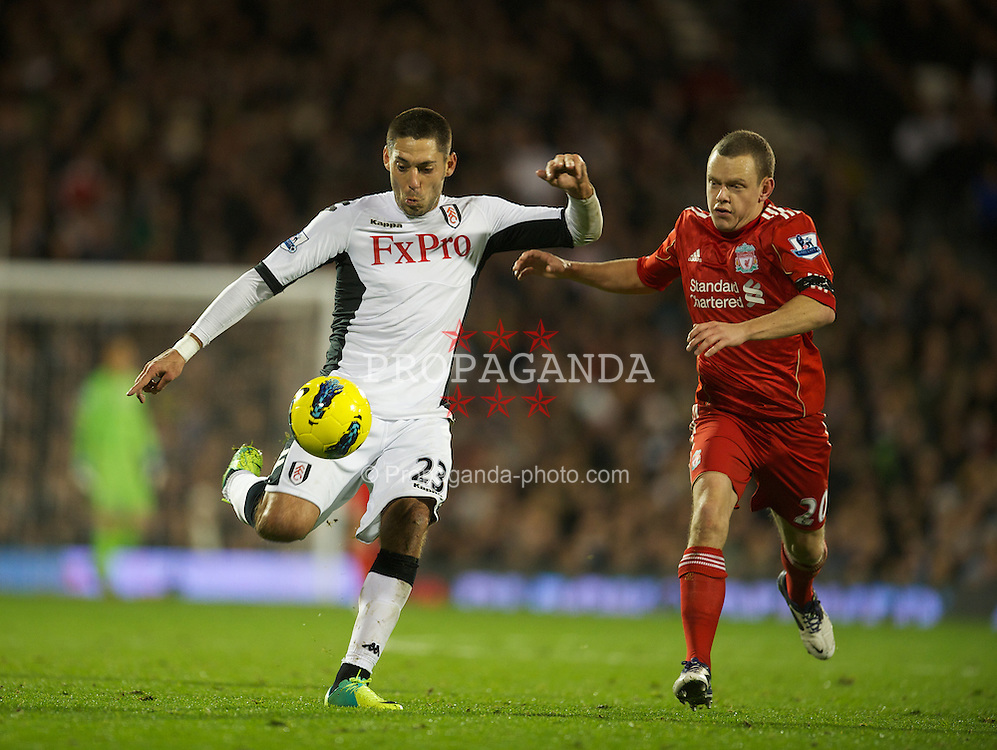LONDON, ENGLAND - Monday, December 5, 2011: Fulham's Clint Dempsey and Liverpool's Jay Spearing during the Premiership match at Craven Cottage. (Pic by David Rawcliffe/Propaganda)