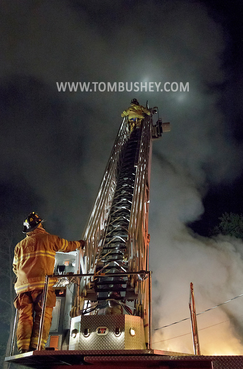 Middletown, New York - Firefighters work to put out a fire at The Engine Shop on North Street on the night of April 20, 2012.