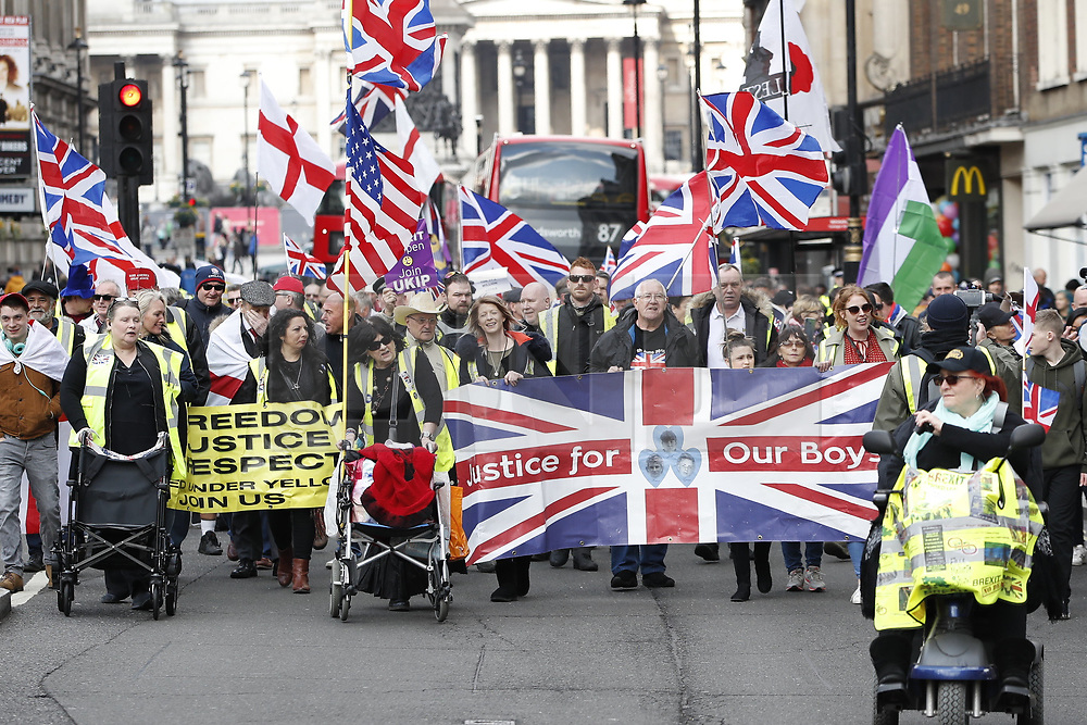 © Licensed to London News Pictures. 13/04/2019. London, UK. 'Yellow Vest' demonstrators and other supporters of Brexit march in Westminster, London to protest at an extension to the UK's withdrawal from the EU. Earlier this week the EU granted British Prime Minster Theresa May an extension to the planned date the UK leaves the European Union. Photo credit: Peter Macdiarmid/LNP