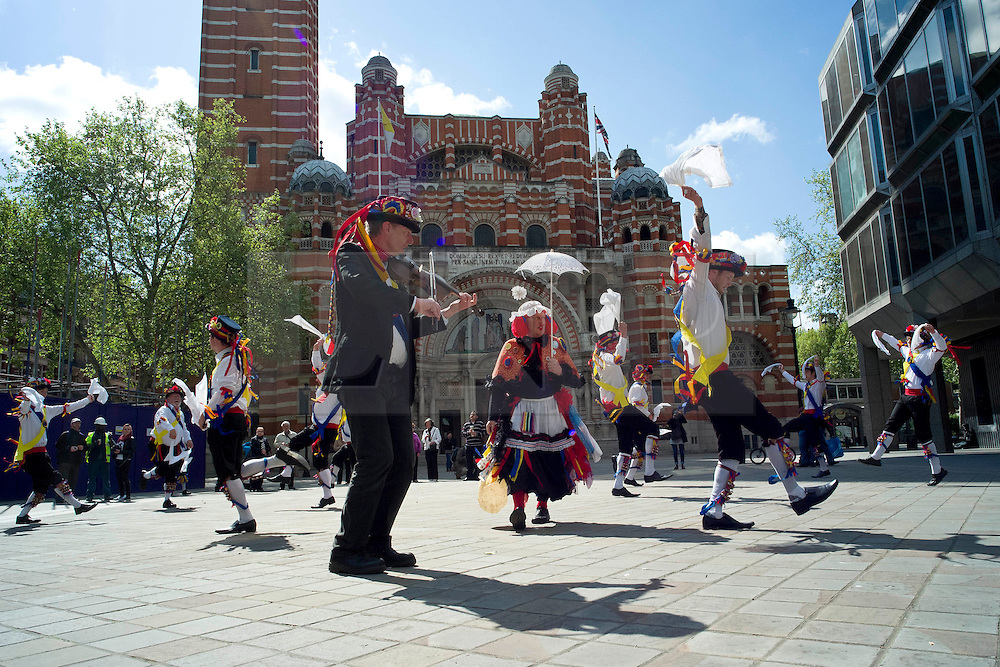 © Licensed to London News Pictures. 12/05/2012, London, UK.  Moulton Morris Men dance outside the Westminster Cathedral in London as Morris men from around the country gather in London for a Westminster Morris Men Day of Dance, Saturday, May 12, 2012. Photo credit : Sang Tan/LNP