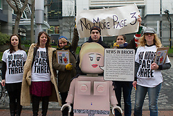 © Licensed to London News Pictures. 26/02/2013. London, UK. 'No More Page 3' campaigners protest with a spoof female Lego model outside The Sun's News International offices in Wapping, East London on 26 February 2013. Demonstrators are calling for Rupert Murdoch to end topless female models in The Sun newspaper, claiming it is unsuitable for family reading and are using a spoof Lego model, nicknamed 'Leanne' as a campaign tool to target the joint promotion running this week between corporate advertisers, Lego and The Sun which is offering free Lego toys aimed at children. Photo credit : Vickie Flores/LNP