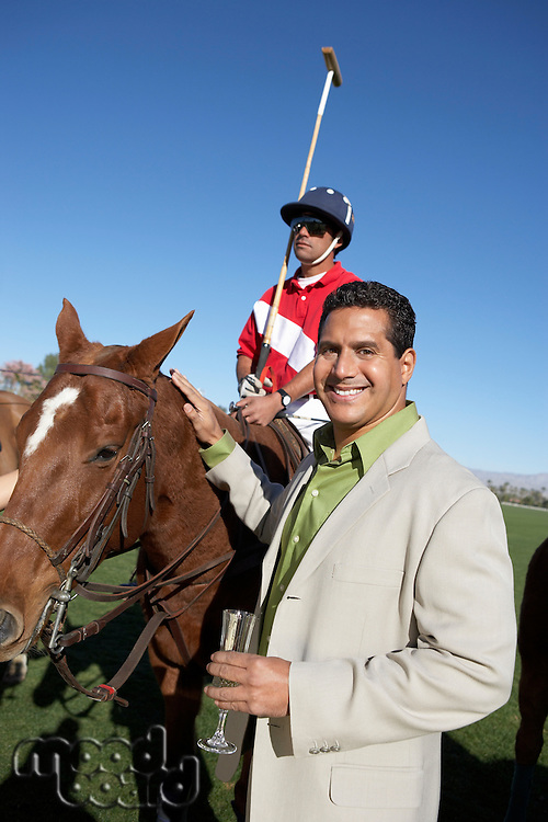 Polo Player and Spectator