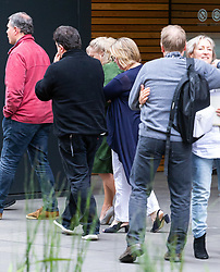 Former Head Teacher at St Margarets C of E School Ruth Ejvet, in  green, leaves the Stratford Employment Tribunal in Poplar where she is contesting her dismissal from her position, surrounded by family and friends to shield her from photographers.London, September 07 2018.