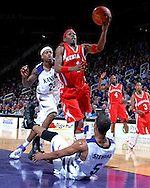 Nebraska guard Sek Henry (1) drives past Kansas State's Cartier Martin (20) and over Wildcat Clent Stewart (5), during the first half at Bramlage Coliseum in Manhattan, Kansas, January 27, 2007.  K-State beat Nebraska 61-45.