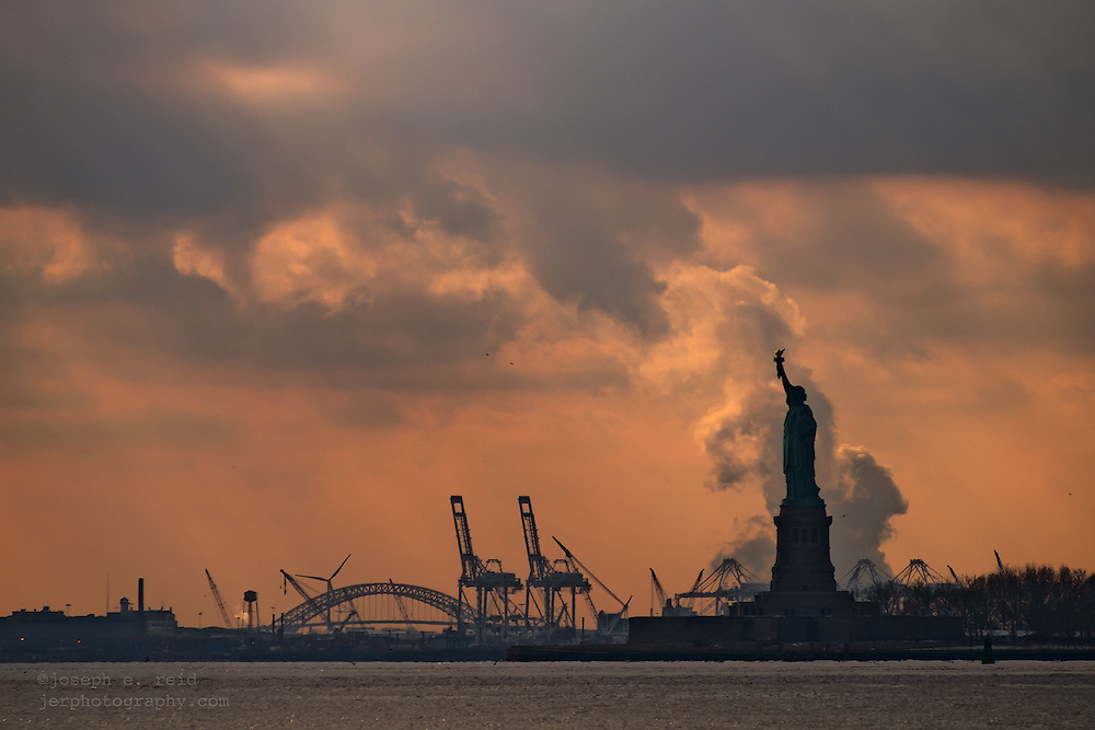 Storm clouds and Statue of Liberty