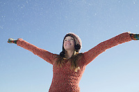 14 year old girl in winter clothing with arms outstretched