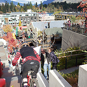 Mountain bike racers tackle the Brecon Street steps in Queenstown during the Corona Dirtmasters Downhill event in Queenstown, Central Otago. Eighty competitors tackled the technically demanding course which started at the Gondola summit and finishied with a run down the steps in Brecon Street, Queenstown. The event was part of the inaugural Queenstown Bike Festival, which took place from 16th-25th April. The event hopes to highlight Queenstown's growing profile as one of the three leading biking centres in the world. Queenstown, Central Otago, New Zealand. 24th April 2011. Photo Tim Clayton..