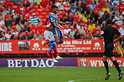 Shrewsbury Town forward Aaron Holloway (20) beats Charlton Athletic defender Patrick Bauer (5) to a header during the EFL Sky Bet League 1 match between Charlton Athletic and Shrewsbury Town at The Valley, London, England on 11 August 2018.