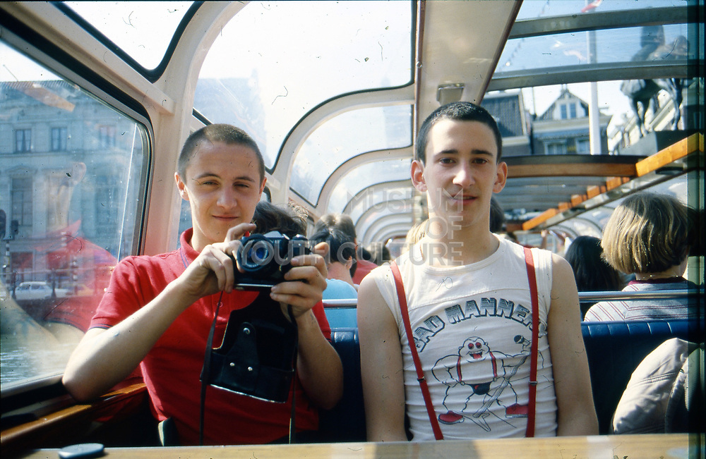 Sean and Gavin on tour boat, 1980s