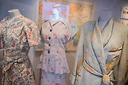 Make do and mend clothes made of silk parachute and map material - Fashion on the Ration: 1940s Street Style – a new exhibition at the Imperial War Museum to mark the 70th anniversary of the end of the Second World War in 1945.  Divided into six sections:  Into Uniform looks at how Second World War Britain became a nation in uniform;  Functional Fashion explores how the demands of wartime life changed the way civilians dressed at work and at home;  Rationing and Make do and Mend will look at why clothes rationing was introduced in 1941, how the scheme worked and how it changed the shopping habits of the nation, including a bridesmaid's dress made from parachute material, a bracelet made from aircraft components, a child's coat made from a blanket and on display for the first time a bra and knickers set made from RAF silk maps for Countess Mountbatten;  Utility Clothing was introduced in 1941 to tackle unfairness in the rationing scheme and standardise production to help the war effort; Beauty as Duty examines the lengths to which many women went, to maintain their personal appearance – and the pressure they felt to do so; and Peace and a new look? which looks at how the end of the war impacted upon fashion, and considers the long-term impact, including a 'VE' print dress worn by the comedienne Jenny Hayes to celebrate the end of the war, and an example of the ubiquitous demob-suit, issued to men leaving the military services. The exhibition runs from 5 March – 31 August 2015