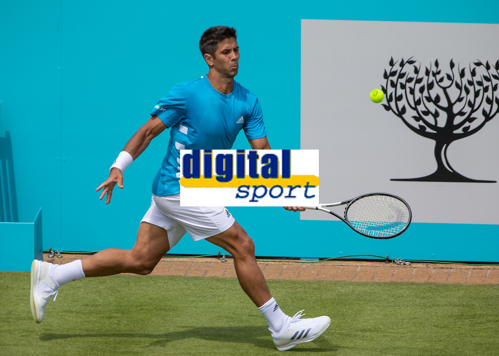 Tennis - 2019 Queen's Club Fever-Tree Championships - Day One, Monday<br /> <br /> Men's Singles, First Round: Fernando VERDASCO (ESP) vs Daniil MEDVEDEV (RUS) [4<br /> <br /> Fernando Verdasco (ESP) scurries across the baseline to reach the ball on Centre Court.<br />  <br /> COLORSPORT/DANIEL BEARHAM