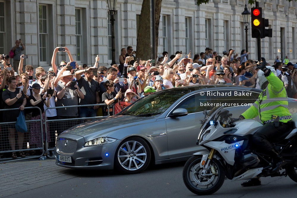 Britain's new Conservative Party Prime Minister, Boris Johnson drives past crowds and enters Downing Street to begin his government administration, replacing Theresa May after her failed Brexit negotiations with the European Union in Brussels, on 24th July 2019, in Westminster, London, England.