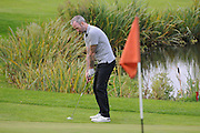 Shaun Derry attempts to finish the 18th during the Julian Speroni Testimonial Golf Day at the Surrey National Golf Club, Chaldon, United Kingdom on 9 September 2015. Photo by Michael Hulf.