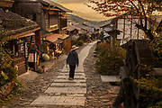 Pilgrim at end of day's walk between Magome and Tsumago, old post road between Kyoto and Tokyo, Northern Japan Alps, Japan,