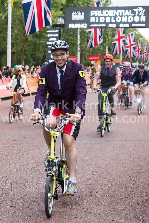London, UK. 3 August, 2019. More than 500 smartly-dressed Brompton riders compete in the Brompton World Championship Final. Starting with a Le Mans-style dash, the race takes place over a 16km 8-lap circuit around St James's Park. It was the fifth successive year that the race had featured as part of the Prudential RideLondon event.