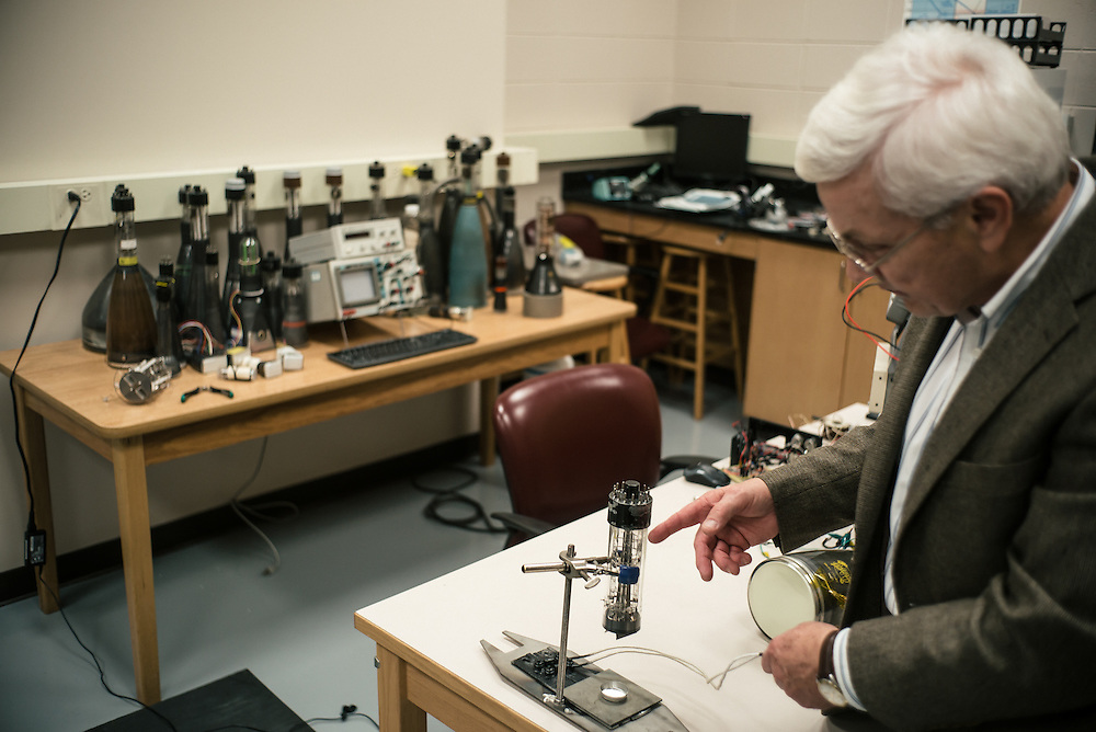 """AUBURN, AL – NOVEMBER 20, 2016: Professor Tony Overfelt examines an antique cathode ray tubes from a television set for use in an additive manufacturing experiment. In 2016, Auburn University received a grant to develop low cost additive manufacturing techniques, which would allow small businesses interested in additive manufacturing to cheaply test the method's viability for their unique production needs. By repurposing the infrastructure inside cathode ray tubes, the existing electron gun inside the tubes is harnessed for additive manufacturing. """"All the infrastructure used in the million dollar machines is right here in these tubes,"""" Prorok said. """"It's more crude, and tuned to a different application, but it's there. We're trying to harness them to do something new."""" Prorok believes the method has potential to become the new paradigm for how newer additive manufacturing machines are built.<br /> <br /> In much of the United States, global trade and technological innovation has failed to produce the prosperity hoped for by political and business leaders. Yet despite formidable economic challenges, some localities are flourishing. In Lee County, Ala., unemployment is below the national average despite the loss of thousands of manufacturing jobs, and the key to the county's resilience may be Auburn University, which provided a steady source of employment during recessions and helped draw new businesses to replace those that fled. CREDIT: Bob Miller for The Wall Street Journal<br /> [RESILIENT]"""