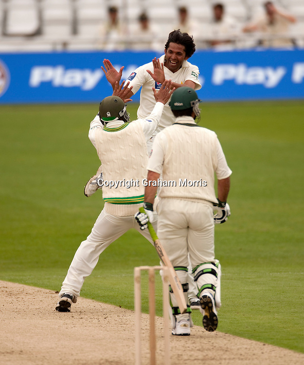 Bowler Mohammad Asif (facing) celebrates as Ricky Ponting (right) is out lbw in the second MCC Spirit of Cricket Test Match between Pakistan and Australia at Headingley, Leeds.  Photo: Graham Morris (Tel: +44(0)20 8969 4192 Email: sales@cricketpix.com) 21/07/10