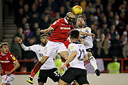 Nottingham Forest defender Yohan Benalouane (29) gets to this header first during the EFL Sky Bet Championship match between Nottingham Forest and Derby County at the City Ground, Nottingham, England on 25 February 2019.