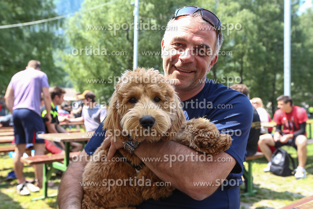 Matjaz Kopitar with dog Gustl at Press conference of Anze Kopitar, players of NHL team Los Angeles Kings during welcome back party for Anze Kopitar at Hrusica, on June 15, 2013 in Sportni Park Hrusica, Jesenice, Slovenia. (Photo By Matic Klansek Velej/ Sportida.com)