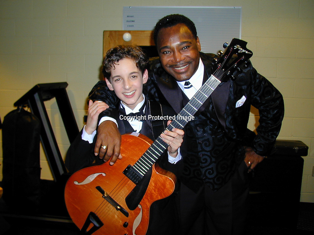 Georges Benson &amp; Julian<br />*****EXCLUSIVE*****<br />42nd Annual Grammy Awards Backstage<br />Staples Center<br />Los Angeles, CA, USA<br />Wednesday, February 23, 2000<br />Photo By Celebrityvibe.com/Photovibe.com