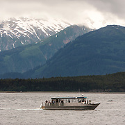 Whale watching boat leaves Auke Bay, Alaska.<br /> Photography by Jose More