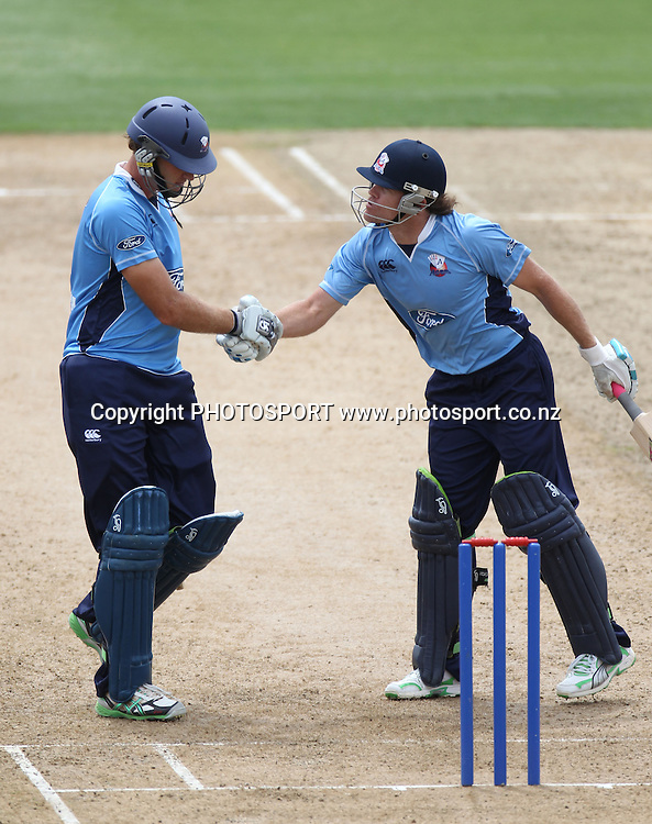 Lou Vincent congratulates Tim McIntosh as he celebrates his century during the semi final ODI playoff match, Auckland Aces v Otago Volts. Colin Maiden Park, Auckland. Wednesday 9 February 2011. Photo: Andrew Cornaga/photosport.co.nz