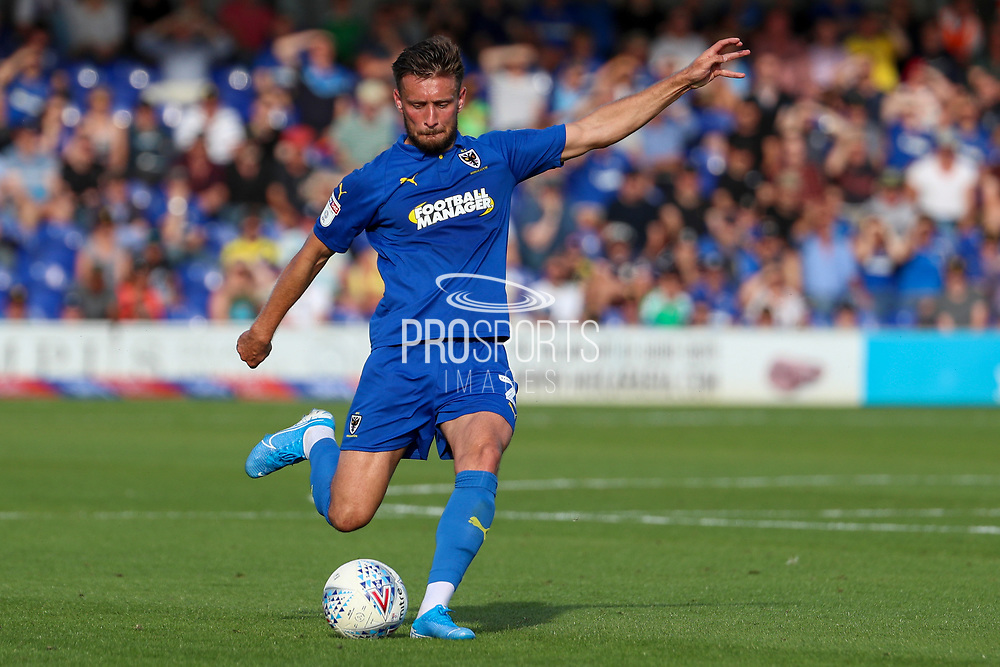 AFC Wimbledon defender Luke O'Neill (2) about to pass the ball during the EFL Sky Bet League 1 match between AFC Wimbledon and Shrewsbury Town at the Cherry Red Records Stadium, Kingston, England on 14 September 2019.