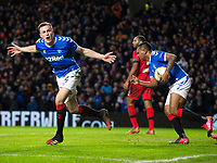 Football - 2019 / 2020 UEFA Europa League - Round of Sixteen, First Leg: Rangers vs. Bayer 04 Leverkusen<br /> <br /> George Edmundson of Rangers celebrates scoring to pull one back and make it 2-1, at Ibrox Stadium, Glasgow.<br /> <br /> COLORSPORT/BRUCE WHITE