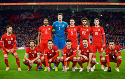 CARDIFF, WALES - Friday, November 16, 2018: Wales' players line-up for a team group photograph before the UEFA Nations League Group Stage League B Group 4 match between Wales and Denmark at the Cardiff City Stadium. Back row L-R: captain Ashley Williams, goalkeeper Wayne Hennessey, James Chester, Tyler Roberts, David Brooks. Front row L-R:  Aaron Ramsey, Joe Allen, Connor Roberts, Tom Lawrence, Paul Dummett, Gareth Bale. (Pic by David Rawcliffe/Propaganda)