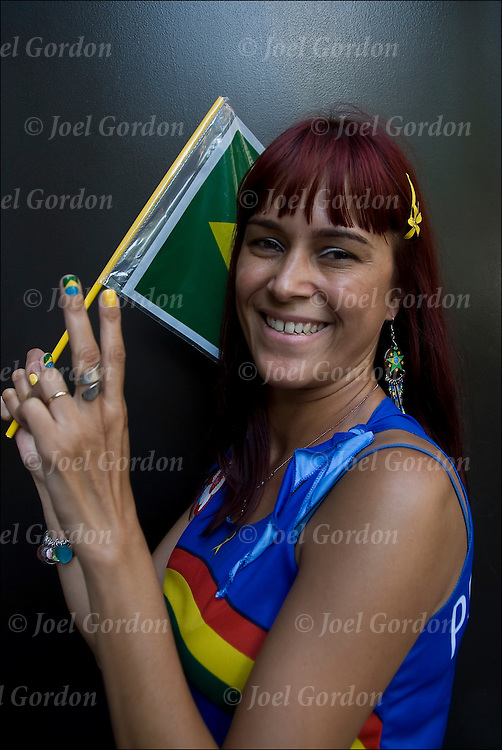 Brazilian from Bahia showing her ethnic and cultural pride holding Brazilian flag and wearing the colors of the flag.