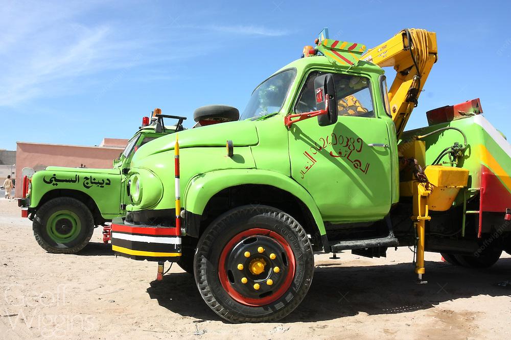 Vintage Ford Trader and Land Rover breakdown trucks Dakhla, Western Sahara