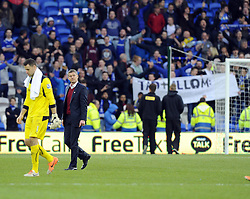 Cardiff City Manager, Ole Gunnar Solskjær leaves the pitch oblivious to a demonstration from Cardiff City fans - Photo mandatory by-line: Joe Meredith/JMP - Tel: Mobile: 07966 386802 22/02/2014 - SPORT - FOOTBALL - Cardiff - Cardiff City Stadium - Cardiff City v Hull City - Barclays Premier League