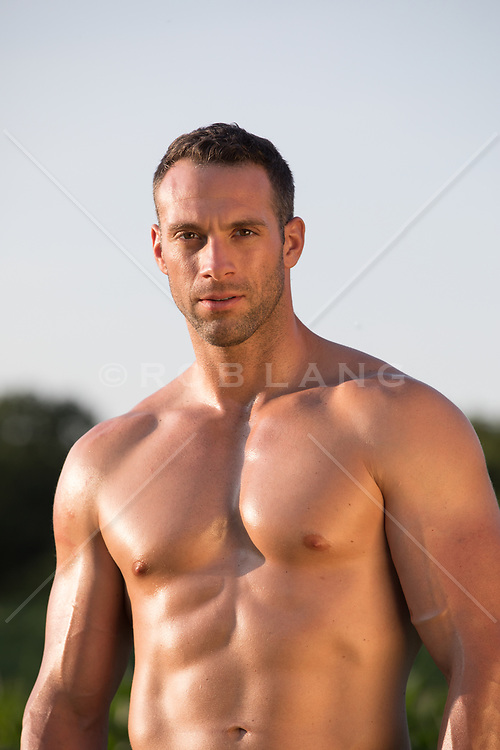 portrait of a muscular man at sunset