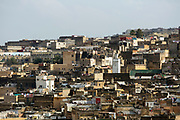 FEZ, MOROCCO 1ST FEBRUARY 2018 - Urban cityscape skyline of clustered rooftops in the old Fez Medina, Middle Atlas Mountains, Morocco.