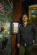 New York, NY, Sept. 10....shots of the restaurant Estela. Sommelier Thomas Carter standing in the entrance, beside the menu, the only indicatin that the restaurant is within.
