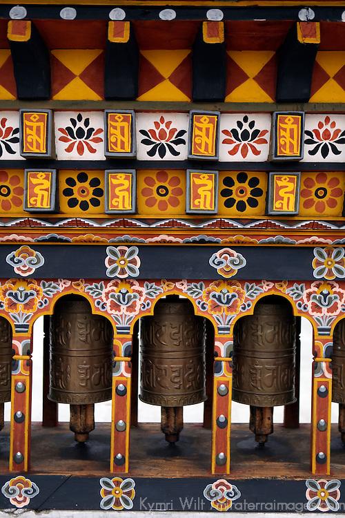 Asia, Bhutan, Thimpu. Three prayer wheels in a central square in Thimpu, Bhutan.
