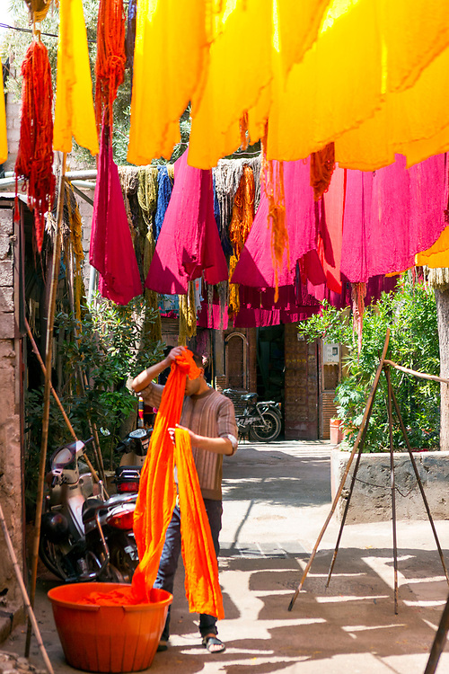 MARRAKESH, MOROCCO, April 30 2018. Colourful fabrics and materials are hung out to dry at the 'dyers souk' in the Marrakesh Medina, Morocco
