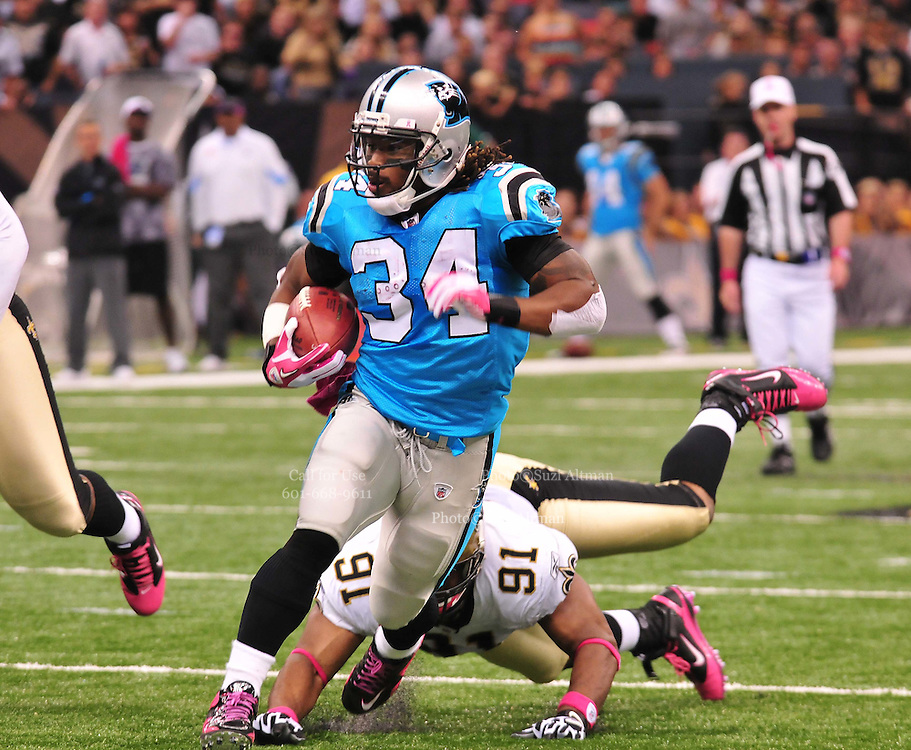 "Carolina Panthers RB DeAngelo Williams 34 breaks a tackle from New Orleans Saints Will Smith 91 and score a touchdown Sunday Oct. 3,2010. The NFL has gone ""Pink"" for October in honor of Breast Cancer Awareness. The Saints went on to win 16-14. John Carney kicked three field goals to help the Saints win. PHOTO©SuziAltman.com"