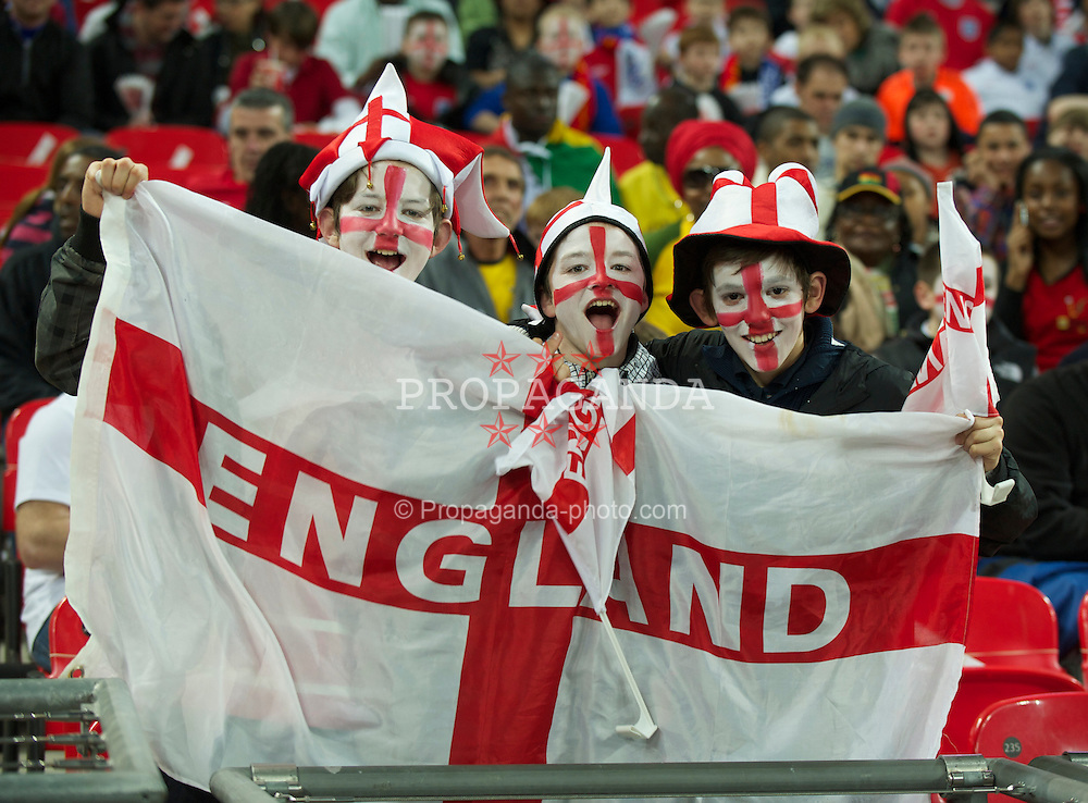 LONDON, ENGLAND - Tuesday, March 29, 2011: England supporters fly the flag of St. George before the international friendly match against Ghana at Wembley Stadium. (Photo by David Rawcliffe/Propaganda)
