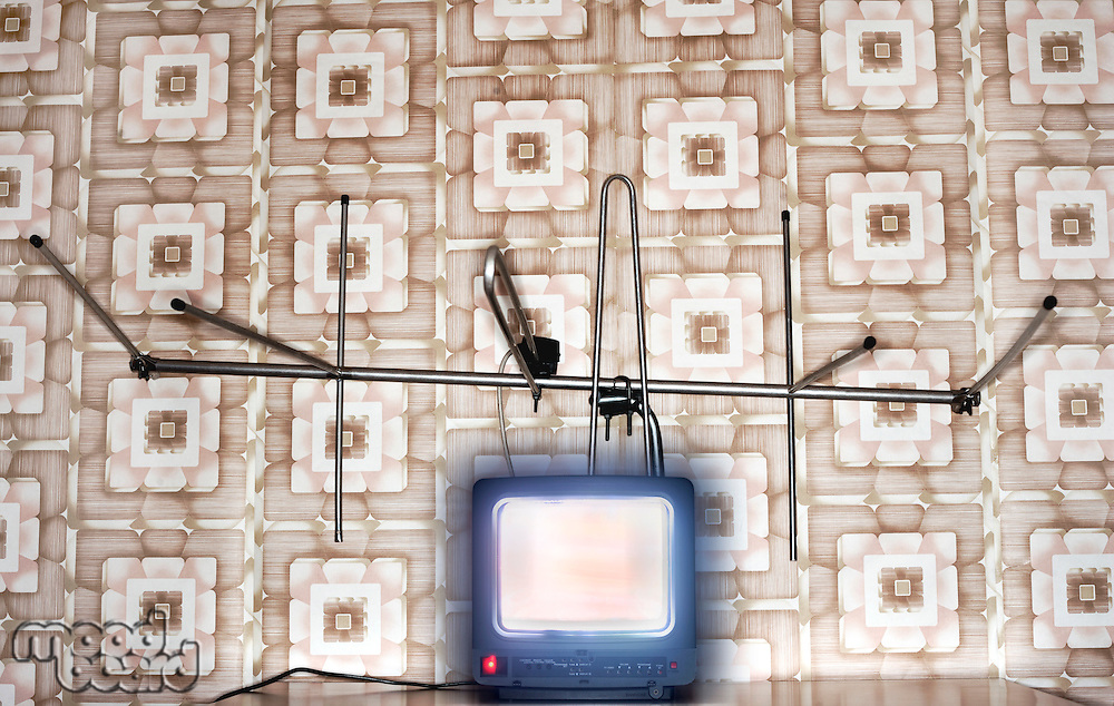 Old fashioned tv set with antenna wallpaper with pattern