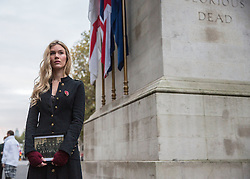 © Licensed to London News Pictures. 23/10/2014.  London.  The Royal British Legion launched the 2014 Poppy Appeal at sunrise this morning at the Cenotaph memorial.  Singer Joss Stone took part in a 30 minute vigil to commemorate fallen soldiers of WW1.  The Poppy Appeal is The Royal British Legion's largest annual charity campaign. In a little over two weeks, some 45 million poppies will be distributed by 350,000 dedicated collectors with the aim of raising £40 million.        Photo credit : Alison Baskerville/LNP